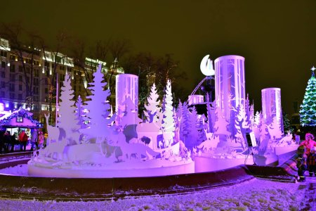 """Moscow, Russia - Jan 16, 2016: New year and Christmas holiday installation """"Winter forest"""" on the Pushkin square during annual festival Christmas light"""