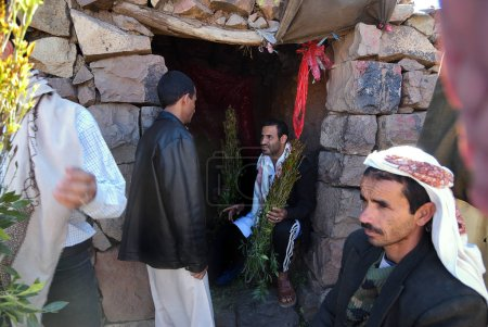 Sanaa, Yemen - March 14, 2010: Unidentified dealers of Khat (Catha Edulis) shown in Sanaa, capital of Yemen. Khat contains an amphetamine alkaloid stimulant narcotic illegal in most countries