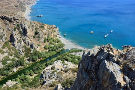 View from above on the Preveli palm beach at Libyan sea, turquoise bay with ships and mountains, Crete, Greece