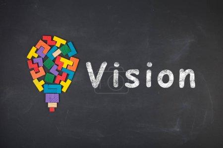 Foto de Concepto de visión empresarial - inscripción y bloques de jigsaw en la pizarra - Imagen libre de derechos