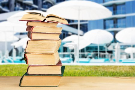 Photo for Stack of books over the natural background - Royalty Free Image