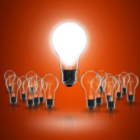 Photo for Idea and  leadership concept -  incandescent light bulb on the black background - Royalty Free Image