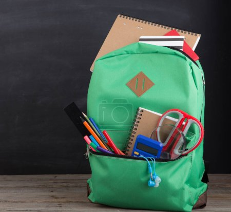 Photo for Education concept - school backpack with books and other supplies - Royalty Free Image