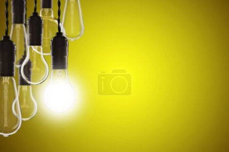 Photo for Idea and leadership concept - Vintage bulbs on the color background - Royalty Free Image