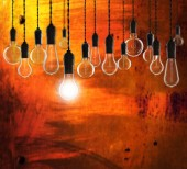 Idea and leadership concept - Vintage bulbs on the grunge background