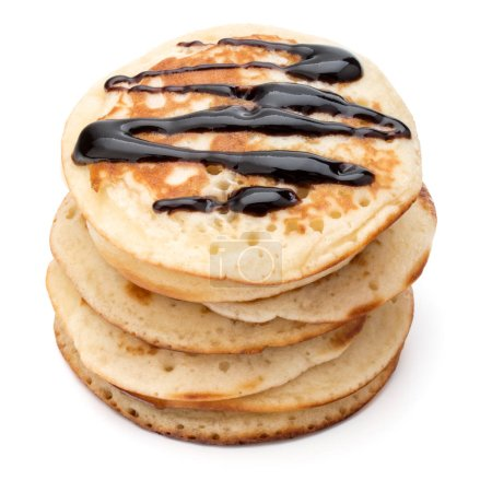 Pancakes  stack with chocolate syrup on white back...