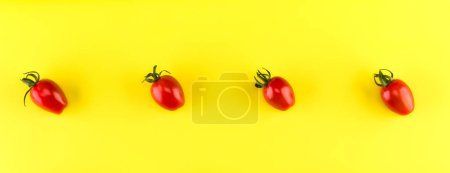 Photo for Food pattern of cherry tomato  isolated on yellow background. Flat lay, top view. - Royalty Free Image