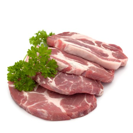 Photo for Raw pork neck chop meat with parsley herb leaves garnish isolated on white background cutout - Royalty Free Image