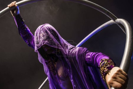 Fairy-tale character assassin in a purple cloak wi...