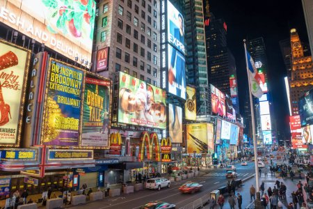 NEW YORK CITY - MARCH 12, 2018: Times Square is a busy tourist intersection of neon art and commerce and is an iconic street of New York City