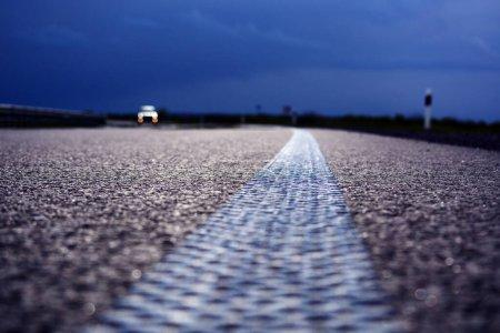 Photo for Asphalt road and stormy sky, travel background, dramatic landscape, transportation background - Royalty Free Image