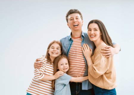 Photo for Happy loving family. Mother, father and children daughters on white background. - Royalty Free Image