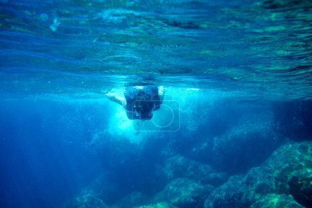 Girl snorkeling in the sea.