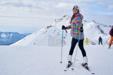 Photo for Skier woman on the background of high mountain Winter sport. - Royalty Free Image