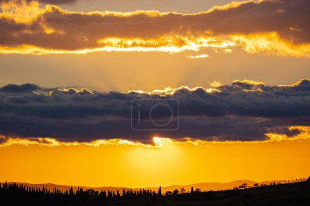 Photo for View of rolling countryside at sunset, Tuscany, Italy - Royalty Free Image