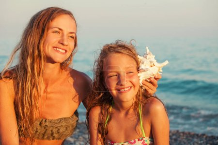 Photo for Child and mother on sea background. Summer vacation. Family - Royalty Free Image