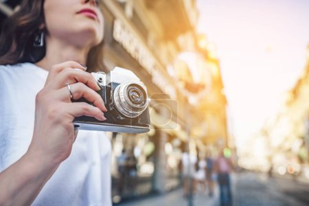 Photo for Young tourist with a retro camera in Europe - Royalty Free Image