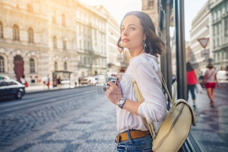 Photo for Attractive blogger with a retro camera in Prague - Royalty Free Image