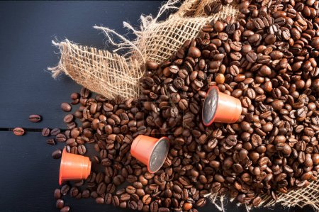 Photo for Grain coffee in sackcloth with coffee capsule - Royalty Free Image