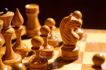 Photo for Chessboard with figures on dark background - Royalty Free Image