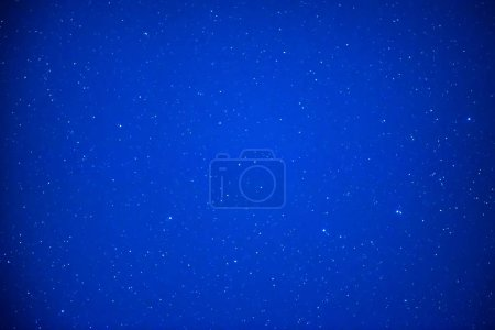 Night dark blue sky with bright stars as space background