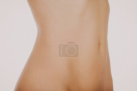 Photo for Smooth skin on women abdomen isolated on white background. - Royalty Free Image