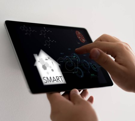 Photo for Man using smart home device with infographic - Royalty Free Image
