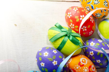 Painted decorated easter eggs on white table