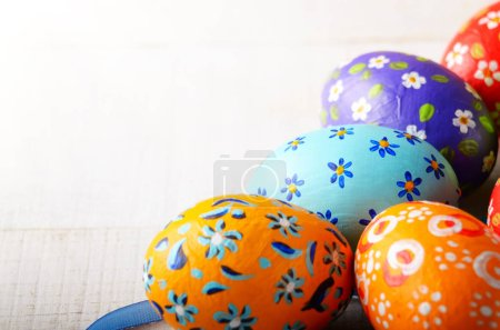 Photo for Painted decorated easter eggs on white table - Royalty Free Image