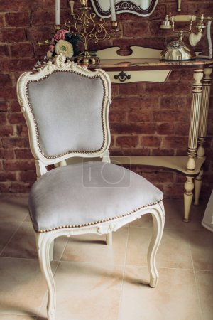 classical style armchair in vintage room