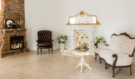 classical style armchair,fireplace and candles in vintage room
