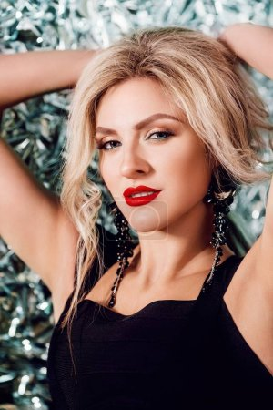 Portrait of beautiful young blonde woman with makeup