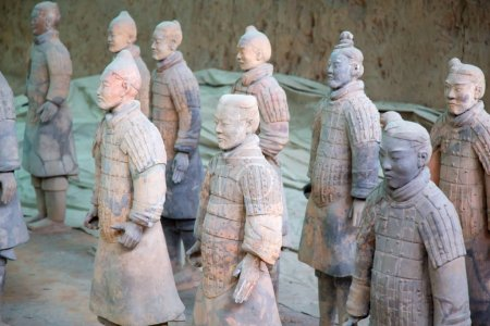 XIAN, CHINA - October 8, 2017: Famous Terracotta Army in Xi'an, China. The mausoleum of Qin Shi Huang, the first Emperor of China contains collection of terracotta sculptures depicting the armored men and horses.