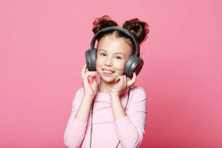Photo for Emotion, childhood, tehnology  and people concept: happy girl  with headphones listening to music - Royalty Free Image