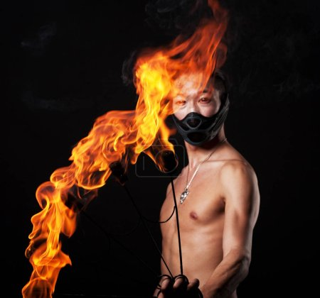 Photo for Young asian man with fire show - Royalty Free Image