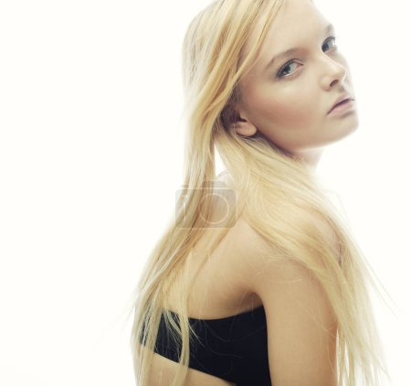 Photo for Beautiful woman with long  blond hair. Fashion model posing at studio. - Royalty Free Image