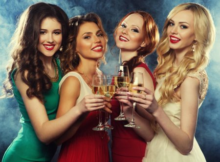 Photo for Lifestyle, party and people concept - Group of partying girls wearing dress, with sparkling wine, close up - Royalty Free Image