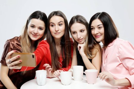 Photo for Friendship, people, and technology concept - happy friends or teenage girls with smartphone taking selfie over white background - Royalty Free Image