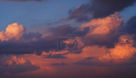 Photo for Sky and orange clouds on an evening summer day at sunset - Royalty Free Image