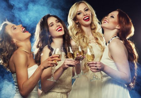 Photo for Lifestyle, party and people concept - Group of partying girls clinking flutes with sparkling wine over dark background - Royalty Free Image