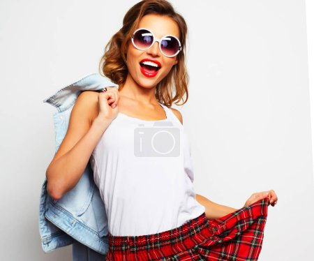 Photo for Lovely student girl wearing big sunglasses over white background - Royalty Free Image