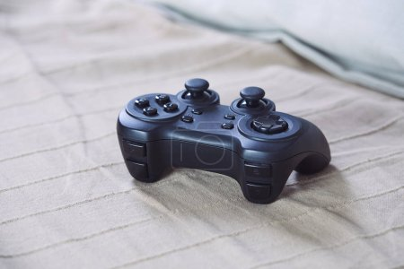 Video game controller on plaid, close-up