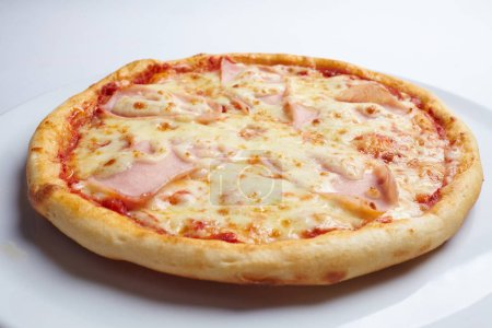 Photo for Tasty pizza on white plate, close-up - Royalty Free Image