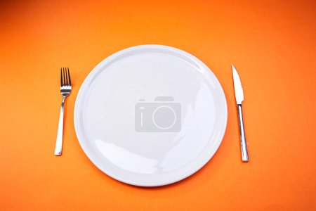 Photo for Empty plate with fork and knife, close-up - Royalty Free Image