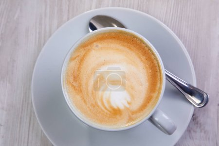 Photo for White cup of hot cappuccino, close-up - Royalty Free Image