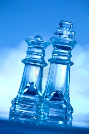 Photo for Brittle transparent glass chess on blue background - Royalty Free Image