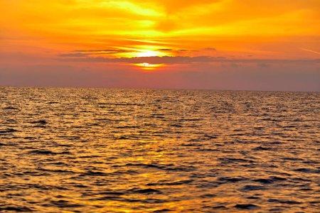 Photo for Bright orange sea surface at sunset - Royalty Free Image