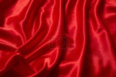Photo pour Fond en tissu lisse satin rouge de luxe pour la célébration, la cérémonie, la carte d'invitation à un événement ou l'affiche publicitaire - image libre de droit
