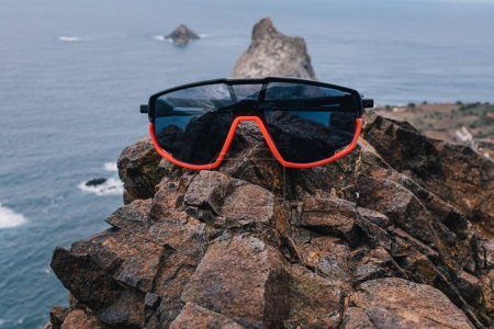 Photo for Mountain run sunglasses on the trail ocean view background. Tenerife Island, Spain - Royalty Free Image