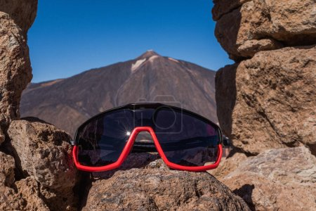 Photo for Mountain bike glasses on the trail against colorful sunset on frosty morning - Royalty Free Image